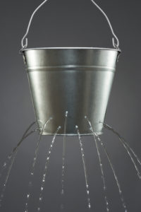 Pic of bucket with holes (water leaking out)