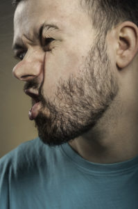 Man with face smashed against glass