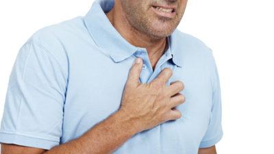 heartburn man holding chest