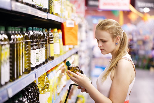 woman-shopping-olive-oil-500x334