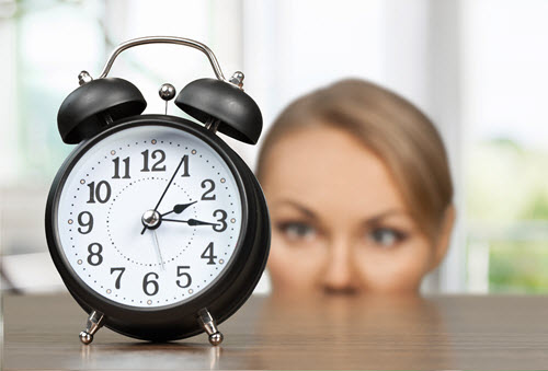 woman watching the clock intensely