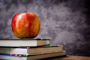 New SCD Research (apple on stack of books)