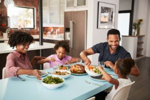 Family with children eating a home-cooked meal
