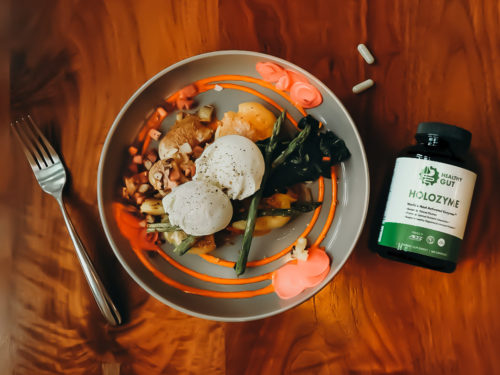bottle of holozyme next to a bowl of food