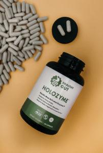 open bottle of healthy gut holozyme